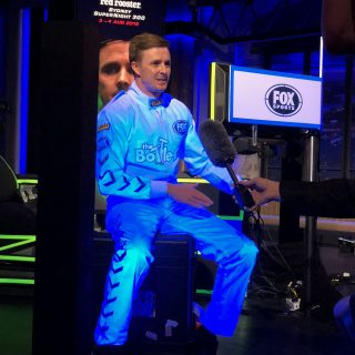 V8 Super Car Drivers Suite that glows in the dark for fox sports filming